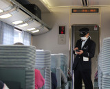 Conductor on our train - while traveling from Nara back to Kyoto