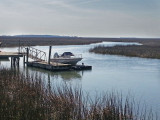 Boat and dock on a large salt water marsh - approaching the beach area on Tybee Island