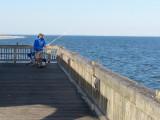 Fisherman on the fishing pier - East Coast of Tybee Island