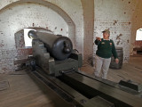 Tour guide explaining how this canon was used - at Fort Pulaski on Cockspur Island, Georgia