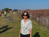 Judy on the upper perimeter with canons in the background - at Fort Pulaski on Cockspur Island