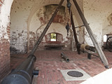 Canon and apparatus to lift heavy pieces - in the fortified veranda of Fort Pulaski on Cockspur Island