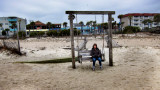 Judy on our favorite swing on the East Coast of Tybee Island