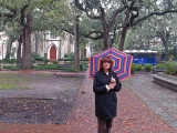 Judy on Madison Square in Savannah, Georgia. St. Johns Episcopal Church (built in the 1850's) is in the background.