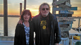 Judy and Richard on the pier behind Coco's Sunset Grille after having dinner at Coco's - Tybee Island