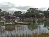 House and dock on a large salt water marsh - approaching the beach area on Tybee Island