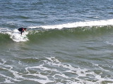 A surfer (in mid-February) as seen from the fishing pier on the East Coast of Tybee Island
