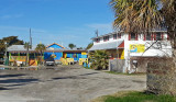 Coco's Sunset Grille (blue and yellow structure) - freshly caught fish for sale in the white structure - Tybee Island