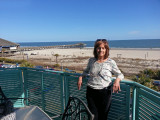Judy on our patio overlooking the beach and the ocean - East Coast of Tybee Island