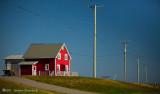 La maison rouge en haut d'la côte !