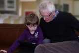Granddad gets a lesson on the iPad, Photo by Gladys