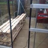 Progress on shelving need 4 more pallets