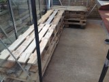 Shelving in lined up and levelled green ground sheet next