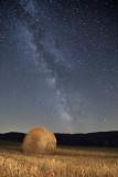 straw bale under the Milky Way