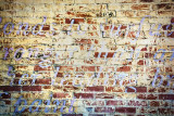 Fading Mural on a Brick Wall
