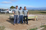 Leigh Bason (middle) and his Canberra Decks crew