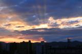 Sunrise, rays of the Sun striking Kyoto, Japan