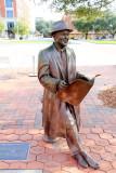 Man reading a magazine, statue, Ellis Square