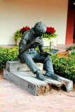 Boy reading book, Harbour town