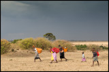 Walking back from Mara River with washed cloths