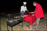 Our Tanzanian chef serving Tommy food our last day in the Mara camp