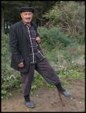 Older Shepherd near Masalli resting his leg -
