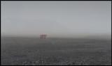 Truck in sandstorm near Vik