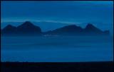 Vestmannaeyar with village Heimaey at dusk