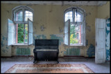Old piano left in one of the men`s buildings