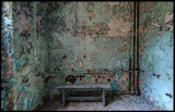 Lonely bench and old painted walls
