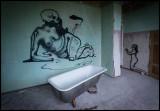 Old bathtub and graffiti