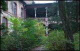 Men pavilion disappearing behind vegetation...