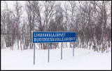 Roadsign in two languages ​​- Finnish and Sami