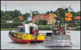 Rescue Boat Väringen towing a fishing boat in to Grönhögen harbor (Öland)