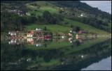 Small village Olden mirroring in the ocean