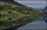 Small village Olden mirroring in the ocean - Norway
