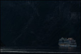 A ship leaving Geiranger late evening