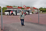 Greg with our tour buses in the background