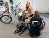 There's Old Skool Helping The Girls Get The Bike On A Holding Stand...