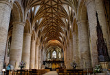 splendid nave arcades, but with later vaulting & very spiky font cover extreme right