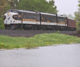 Eastbound 956 passes Lake Wells during a hard downpour
