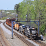 A Southbound rail train with a SD70 on the point at Revilo