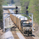 NS 275 comes South under the signal bridge at Whitley, with 10,000 feet of racks in tow