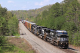 A old CR GE in new paint brings 142 down the hill at Parkers Lake