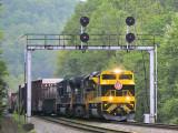 Virginian 1069 brings Northbound 142 under the signal bridge at Southfork KY