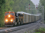 BNSF, NS and UP power bring I-39 by the East end of the siding at Waddy
