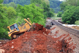 A CAT D8 dozer works  to re-profile the North approach to the Pittman Creek bridge