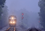 The classic EMD Bulldog nose of NS 4271 appears through the pre-dawn fog as Southbound 955 eases past the signals at MP 115.2