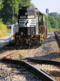 NS 5512 is tied down with a work train in the seldom used house track at Talmage.