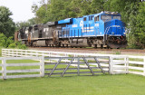 Conrail 8098 leads Eastbound coal loads through downtown Vanarsdale